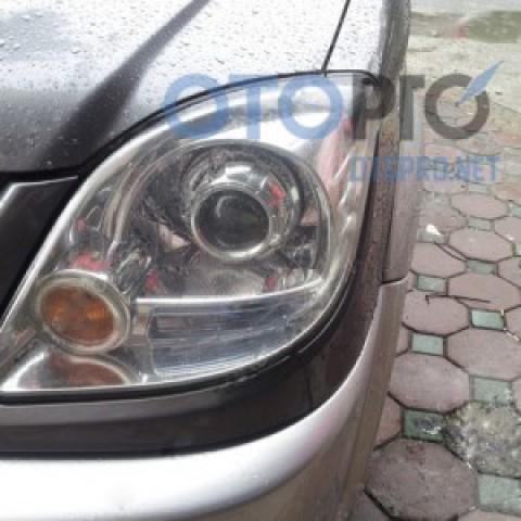 Độ đèn pha bi xenon cho xe Mitsubishi Jolie 2005