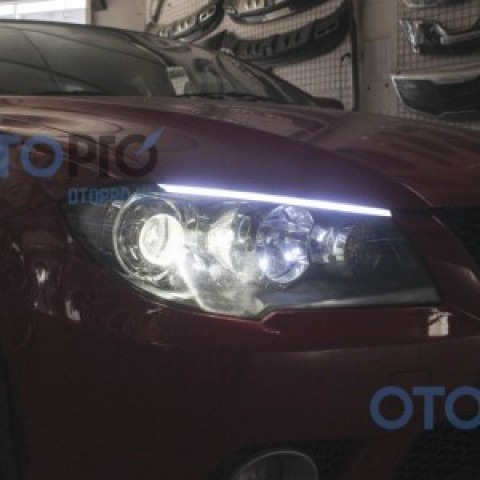 Độ đèn pha bi xenon, dải LED mí khối xe Mitsubishi Lancer