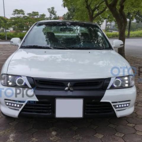 Độ đèn bi xenon, angel eyes, LED daylight xe Lancer GLX
