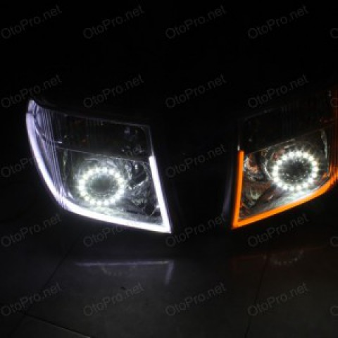 Độ đèn bi xenon, LED mí khối trắng vàng, angel eyes lens cho Navara