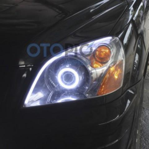 Độ đèn bi xenon, angel eyes, LED mí khối xe Pilot 2005