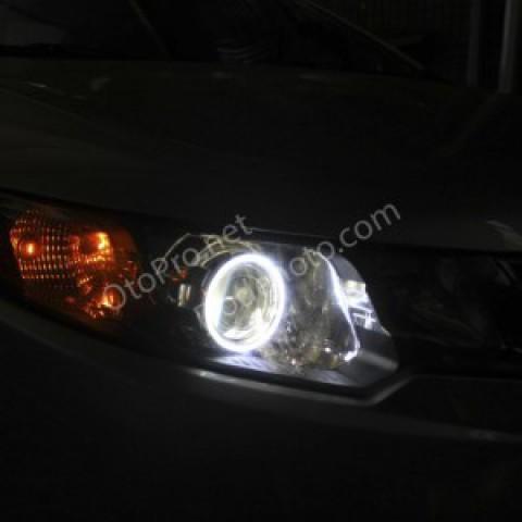 Độ đèn bi xenon, angel eyes LED khối cho xe Kia Forte
